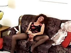 Respectable mature woman with dildo