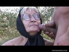 Perverted granny fucked doggy style in woods