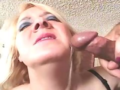 Blonde granny in stockings gets facial